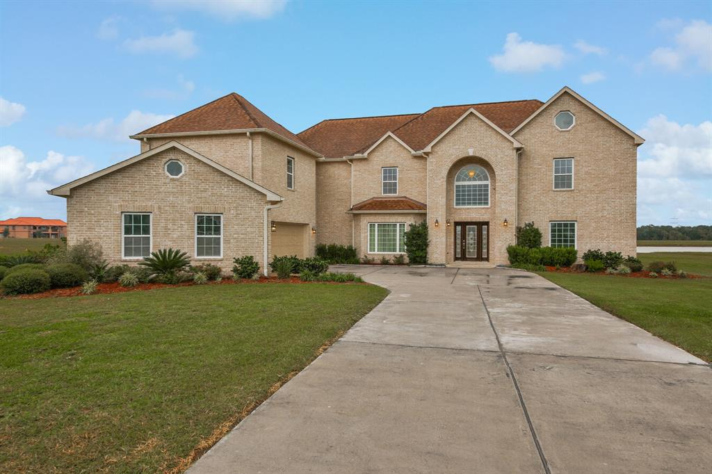 Fall in love with this custom-built lakefront home on an oversized 1-acre lot in Brazos Lakes. This well-appointed property features an open floor plan with a grand 2-story foyer, wrought iron basket spindles, crown molding, living room with tray ceiling & gas fireplace, formal dining room, game room, media room, & flex room on 2nd floor that can be used as a man cave with its own half bathroom. Other notable features include hardwood flooring in the dining room & master, tile flooring in the common areas, 3-car attached garage, a septic system, & covered patio overlooking the lake. The spacious island kitchen boasts granite countertops, corner pantry, & gas cooktop with stainless steel range hood. Relish in the master suite featuring a tray ceiling, gas fireplace, sitting area, his & her walk-in closets, separate vanities, whirlpool tub, & shower. Conveniently located less than 15 miles from Sugar Land Town Square, home to shopping, dining, fitness classes, & events. Call today!