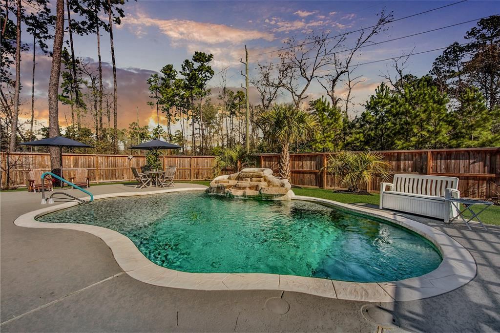 Pristine 1 story Trendmaker home with backyard Oasis in sought after 80ft. gated section Benders Landing Estates! Endless features include like-new wood tile floors, breathtaking white kitchen with Upgraded Monogram appliances, six burner range, pot filler, Quartz island with custom cabinets and coordinating subway tile back splash. Premium lot with no side neighbor,  3.5 car garage, Large game room used by sellers as craft room which has been plumbed for a wet bar, plantation shutters, 8 ft. farmhouse doors, Windmill fan in living room, leaf guard gutters, security cameras, no back neighbors, whole house water softener (reverse Osmosis). Head to pool area from custom sliding glass doors that compliment ultimate views from inside the home. Backyard has Pool with waterfall, Pebble Tec, heated, Self cleaning system and an added Pergola for ultimate entertaining. Only 23 homes in this section for plenty of privacy. Pride of ownership here! Do not miss the Gem. Mrs. Clean lives here.