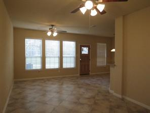 Family Room with wall of windows to enjoy the view of Walden Golf Course
