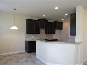 Kitchen is open to Family and Breakfast Bar provides additional seating