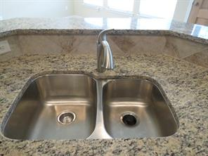 Beautiful Granite and Stainless Steel Undermount Sink in Kitchen