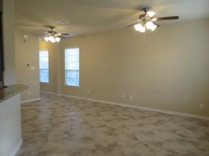 Family Room with neutral Ceramic Tile Flooring