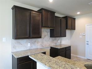 Ceramic Tile Backsplash and Coffee Cabinets in Kitchen