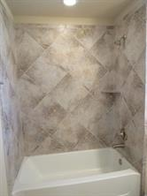 Neutral Ceramic Tile Surround in Hall Bath Upstairs