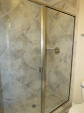 5 ft. Glass enclosed walk-in Master Shower with Neutral Ceramic Tile Surround