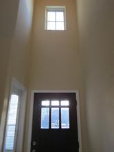 Soaring Ceiling in Foyer with Window above