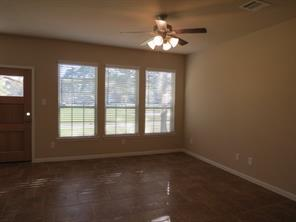 Family Room with Wall of Windows to enjoy the beautiful view of Walden Golf Course