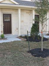 Grassed and Landscaped front Yard with Sprinkler System