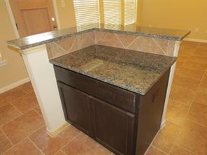 Island Kitchen features Baltic Brown Granite Counter Tops