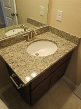 Hall Bath Vanity with Granite and Undermount Sink