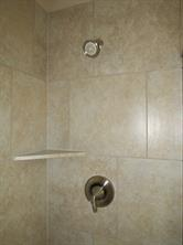 Master Shower features Neutral Ceramic Tile Surround