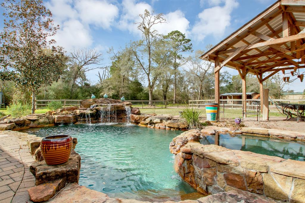Unrestricted 2.5 Acres with 2 Story 2 Bedroom/2.5 Baths.  Kitchen was built for a chef.  Beautiful Pool. 3 Door Metal Garage with lift.  There is a small apartment at the side of the metal building.  Remodeled bathrooms.