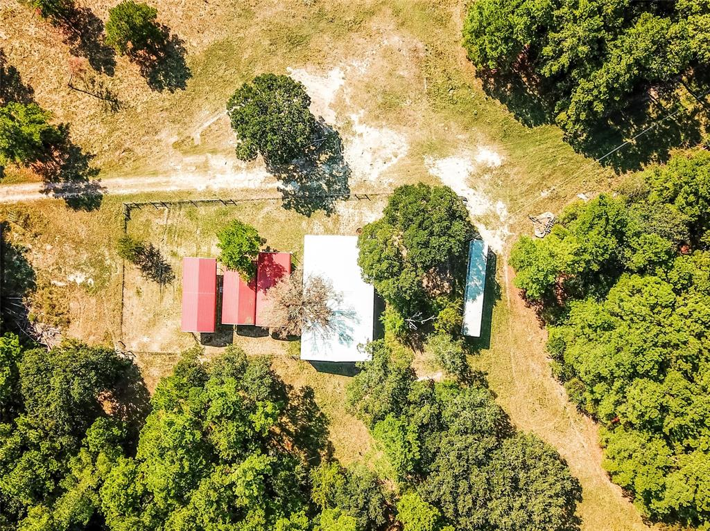 Located in beautiful Houston County in East Texas and just south of Crockett, TX, this tract offers hunting, pasture, trees - plantation pines and hardwoods, several ponds, a meandering creek, and recreational fun. Approximately 210+ acres. Public Water and electricity in place. This property features a large barn with several stalls, septic, and water plus separate hay barn, fencing and cross fencing. A beautiful tract offering a get-a-way retreat and enjoyment for family and friends.