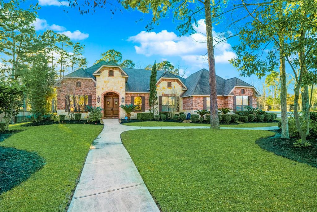 Welcome home to 27423 Siandra Creek Lane in the sought after Benders Landing Estates.  Magnificent 1.5 story on over an acre. Walk in through the custom wood doors and enjoy the finishes this home has to offer.  Travertine floors, custom cabinets throughout, crown molding, built ins, upgraded fixtures and much more.  Entertainers dream with this open concept and chefs inspiring kitchen. Kitchen has upgraded appliances, double oven, huge island, breakfast bar and wine grotto. Spacious living room with stone fireplace for those chilly nights. Master and all bedrooms are located on the first floor.  Gameroom and media are upstairs.  Media room is equipped with a projector tv for those family movie nights. Covered patio in the back with an outdoor kitchen.  This backyard is big enough for any size pool.  Close to I-99, Hardy Toll Rd, and I-45. Enjoy the clubhouse, olympic size pool, fishing, tennis or basketball.  This subdivision has it all.  Let's call this home yours for 2019.