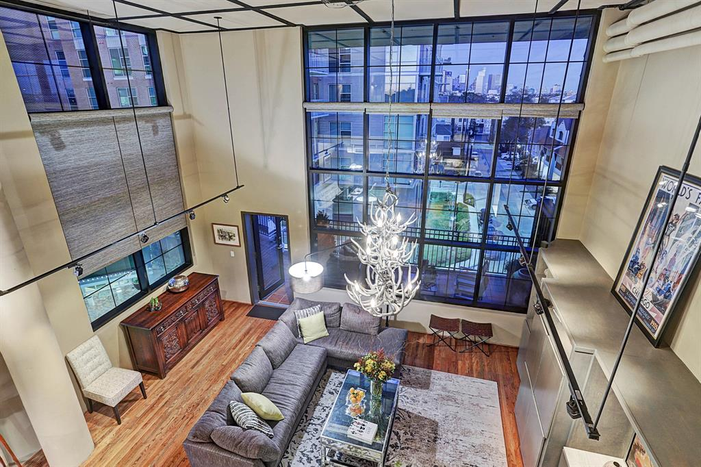 Fabulous corner unit with a great view of downtown. Dramatic 2 story living area open to the gourmet kitchen and dining room. Lovely custom bar area with dual white/red wine fridge and an amazing wall of built in storage. Downstairs bedroom has an amazing Murphy Bed system that allows the room to have multiple uses. The upstairs family room is open to the downstairs and also offers a fantastic view. Huge living size terrace is perfect for outdoor grilling and entertaining. Master Bedroom suite features an amazing built-in addition closet system along with the large walk in closet. The gorgeous spa like Master Bath boasts a large walk in shower, separate jetted tub, double sinks and vanity area. This home is located within walking distance to some of Houston's finest restaurants, River Oak Shopping Center & Buffalo Bayou Park!