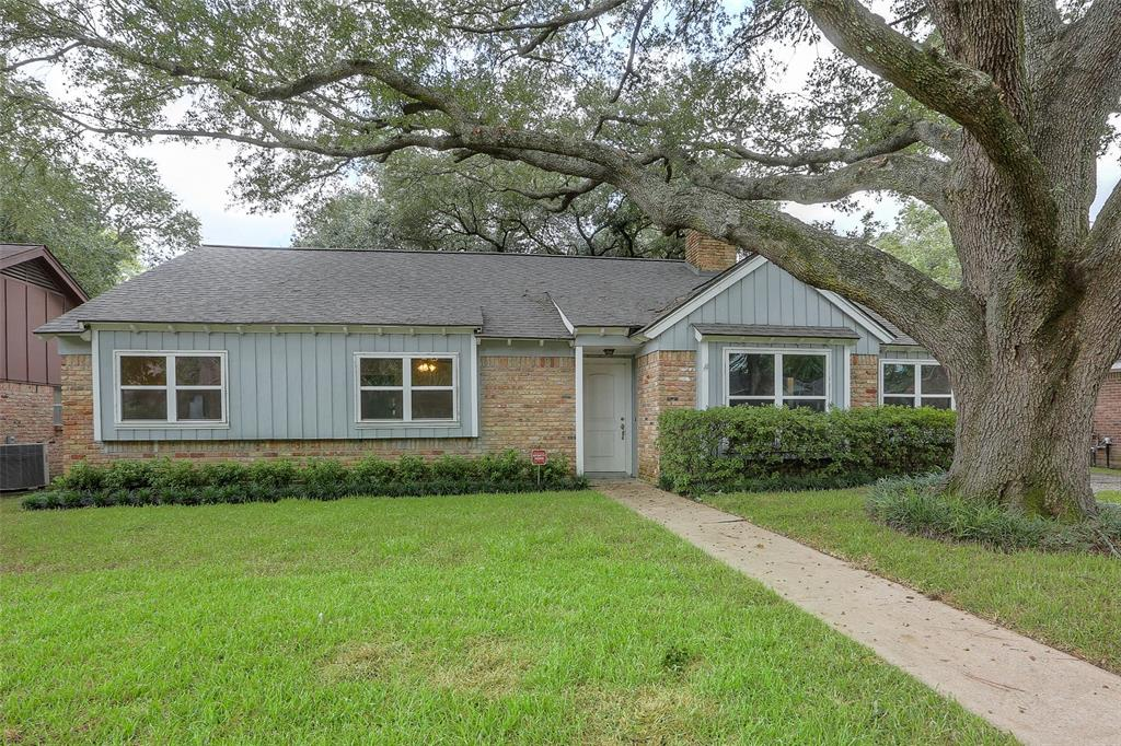 Beautifully updated 4 bedroom home with a recent roof, new windows, and new landscaping.  Check out the awesome oak tree.