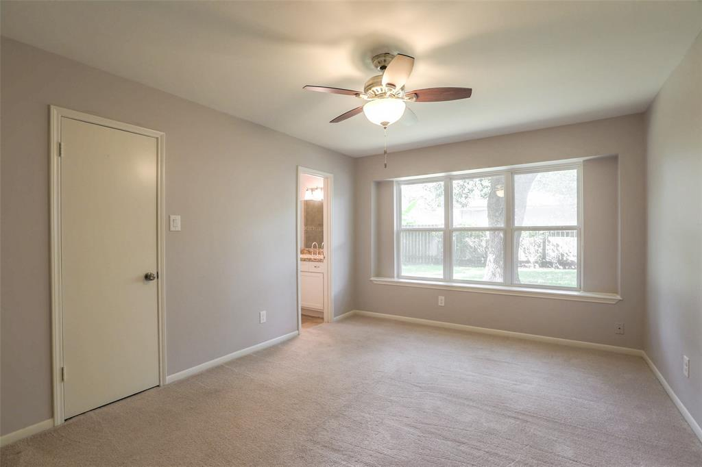 Master suite features a walk-in closet and updated bath.