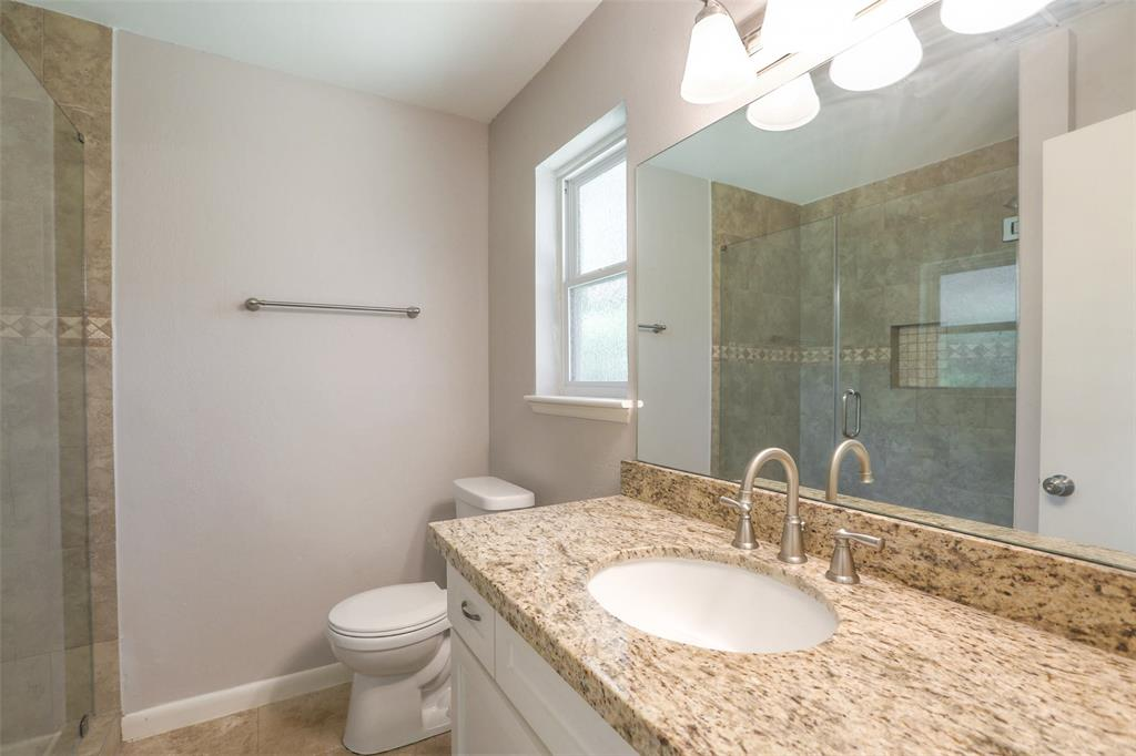 Master bath with granite counter top and updated shower.