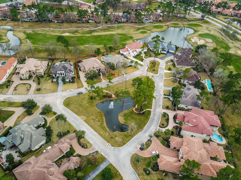 NEVER FLOODED! From the moment you enter, you know you're home. Golf Course Estate Home has been immaculately maintained by only original owners & still looks brand new! High ceilings, & views of Northgate Golf Course are seen from almost every room. Open Floor plan w/luxurious touches throughout. Family Room has fireplace w/granite surround; opens to Kitchen which is a cook's dream w/stainless appl; granite ctrs, incl. a HUGE Ctr Island & Butlers Pantry w/Wine Refrig. White, hand-crafted custom cabinetry. Master on 1st floor w/trayed ceiling, sitting area.  Master bath has oversized tub, large separate shower; granite ctrs w/2 sinks, & custom cabinetry. Gameroom up w/balcony overlooking golf course. 2 of 3 bedrooms up also have balconies!  3 car garage w/work bench & tons of storage. Lush landscaping & unbelievable views from covered back patio. Outdoor Kitchen w/Viking Grill. Plenty of room for a pool. Full House 22 kw Generator. HUGE shell space to add 1 more room. Gated Community.