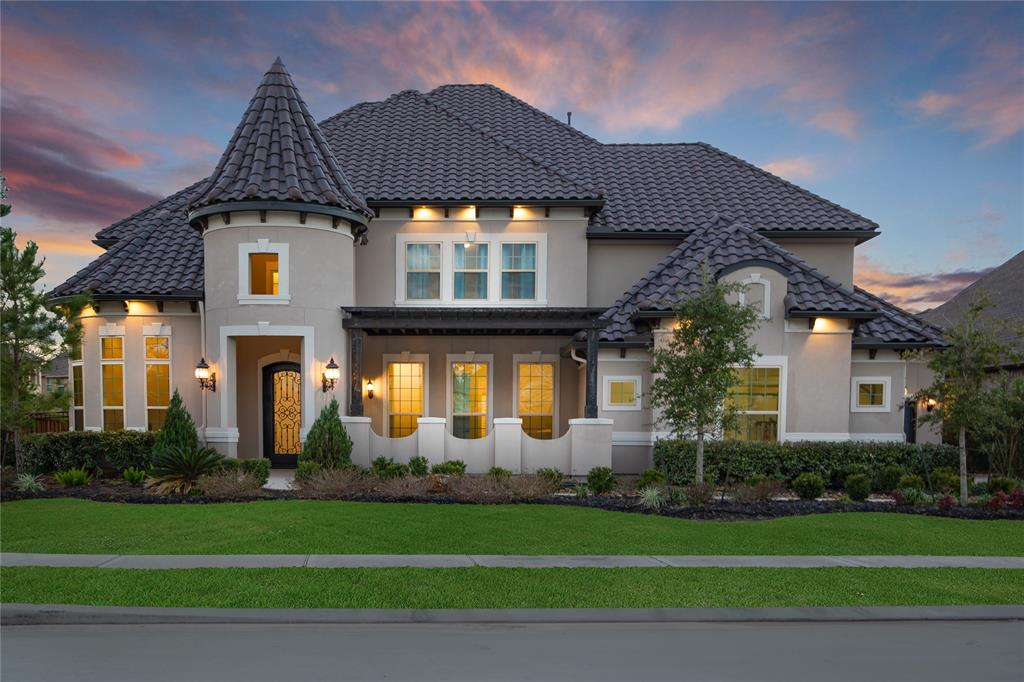 DRENCHED in LUXURY, GREAT LOCATION, & on over 1/2 acre CORNER lot! Only minutes to Grand Parkway, easy commute to IAH, & all The Woodlands has to offer. Modern 2 bedrooms down floor plan w/ SMART HOME system, stunning architectural designs, modern lighting, & wood floors throughout first floor. Over-sized GRANITE ISLAND, white cabinetry w/ glass uppers, JENNAIR appliances - double ovens & gas cooktop, 7x6 wine grotto, & butler's pantry. Master bedroom w/ trey ceiling, his & her vanities, HUGE mud set shower w/ dual sprays & bench, garden tub, & 2 walk-in closets! Iron spindle staircase leads to upstairs game room w/ wet bar plus media room. Outdoor living features front courtyard & 2 story covered patio in backyard w/ outdoor fireplace. Oversized 4-car epoxy finished garage. FIRST class neighborhood amenities include: 9,000 sq ft amenity center, lap pool & lazy river, 24 hr fitness center, tennis courts. Zoned to CONROE ISD & the brand new Grand Oak High School. Your dream home awaits!