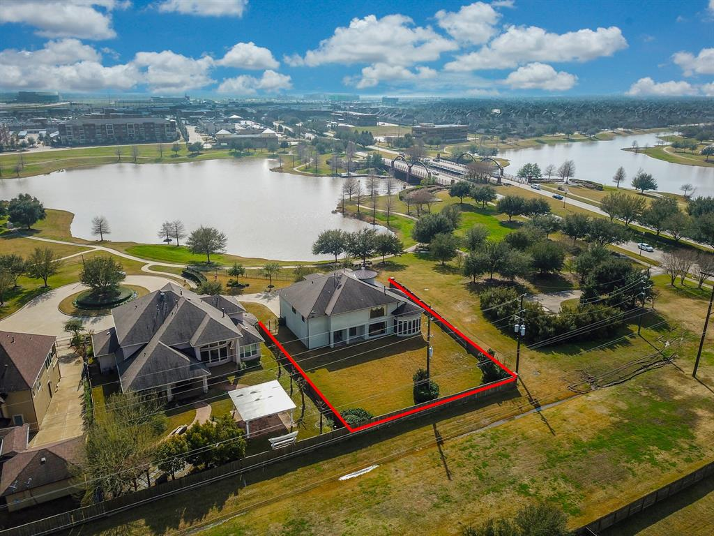 Beautiful custom home sitting on almost half an acre corner lot facing the lake in the most sought after community of Telfair in Sugar Land. This home offers a huge yard to design your own dream backyard oasis as you can add a pool, gazebo, or make a park/playground - the possibilities are endless. The home features 5 bedrooms and 3.5 baths and a 3 car attached garage. Downstairs is formal dining with a wine room, study with a gorgeous view of the lake, den with tall ceilings and glass windows. The kitchen open ups to the family room with huge pantry and butlers pantry. Massive Master bedroom with bay windows. Upstairs you have 4 bedrooms and 2 baths, spacious game room and don't forget -  media room behind the bookshelf. Besides all the great features the best part is the LOCATION! LOCATION! LOCATION! The home is zoned to all 3 exemplary Fort Bend Schools. Minutes from all major highways, malls, restaurants, and theatres.