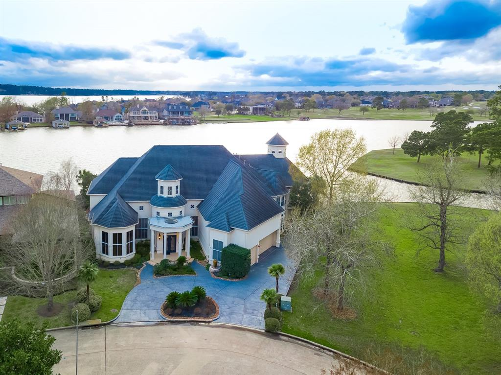 "Stunning estate home located across from Bentwater Island. Luxury lake living, along the shores of Lake Conroe in the exclusive Estates of Bentwater. Located on a large lot in an oversized cove for safe boating & skiing.  Master suite & a secondary bedroom on the first floor. Three additional bedrooms w/en suite baths, game room & a large extra room which could be a theatre or exercise space upstairs. Large butt glass windows allow beautiful views both down & upstairs. Custom crown moulding from 5-22"", plantation shutters, lighted bookcases, & custom built-ins, some w/faux finishes. Open to the breakfast area & family room, kitchen offers the gourmet cook a happy space to work. Ascending up the staircase you'll find a one of a kind mural leading to a balcony perfect for taking in the views. Step outside the French doors to a beautiful porch w/marbella stone & granite floor. Enjoy the infinity edge pool w/spa, dolphin water feature & an efficient summer kitchen. Area for an elevator"