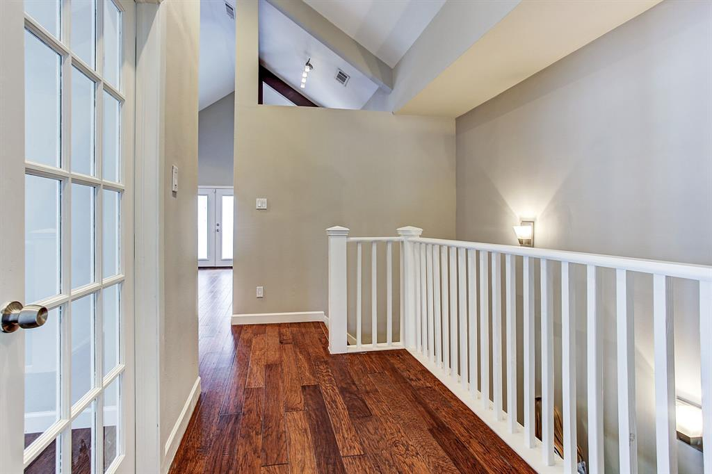 View of beautiful hardwoods, french doors to office/flex space and gorgeous staircase.