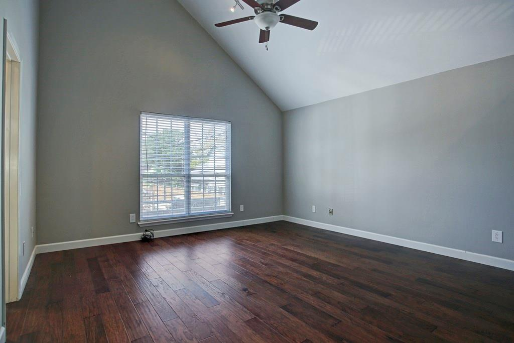 Spacious master bedroom features vaulted ceilings, hardwood floors, en-suite bathroom and a roomy walk-in closet.