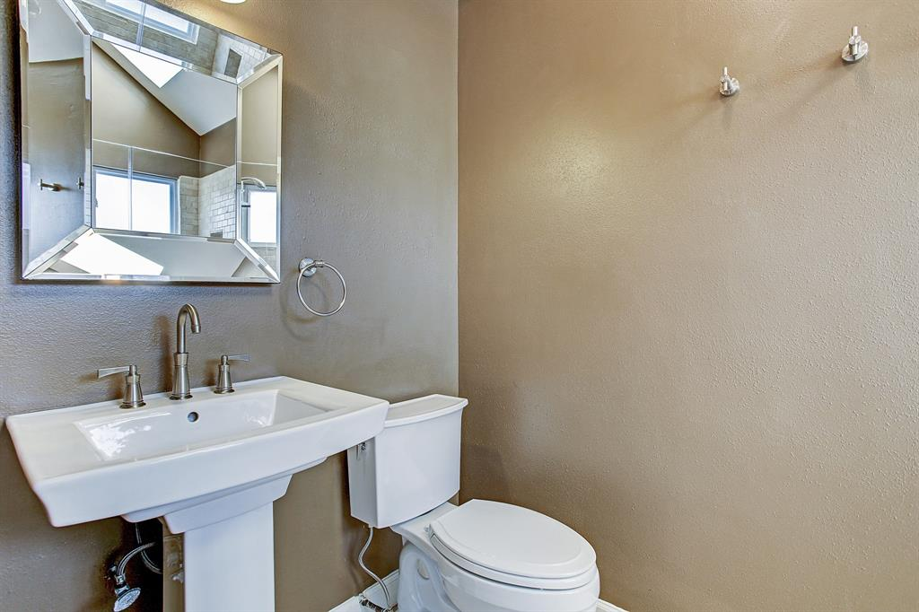 Beautiful master bathroom offers updates such as this upscale vanity and tiled walk-in shower.