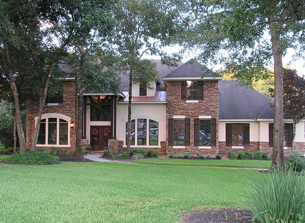 **HIGH & DRY!! HOME NEVER FLOODED!!** French Country Style Home, Completely Open Concept. Gourmet kitchen, HUGE family room w/windows galore, master suite w/whirlpool tub, multilevel media room, large game room, soaring ceilings with custom triple crown molding, remote fire place, office study, flex room, hardwood and tile floors. One acre wooded lot w/gorgeous mature trees. 12x15 storage shed with concrete floor. Driveway fits 10 vehicles. Custom pool w/waterfall & spa, huge backyard patio.