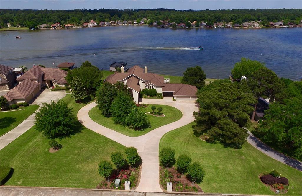 Inclusive Lake Conroe Waterfront Vacation/ Family/ Generational Retreat, fully furnished, w/ boat&watertoys on 2 huge WF lots w/ Sparkling Pool! Gated community offers security! Breathtaking views from all rooms! The Chef's Kitchen/Dining area is the perfect place to gather! Granite, SS Appliances & mega storage! The custom designed Living has double doors to the balcony w/ breathtaking views of the lake in every direction! Two bedrooms w/ private baths are on this level also. Downstairs are 3 additional bedrooms w/ private baths, a central Den, a 2nd full Kitchen w/ pass-thru window to the pool/patio, a custom designed temp. controlled wine tasting rm & a large Study/ game room w/ an unforgettable children's nook! The inviting pool is fenced near the huge covered patio, perfect for all to gather for summer fun!! Lakeside, a large sun deck covers multiple boat slips. Generator! Must see to appreciate it's wonderful attributes! Hurry, this magnificent waterfront home will not last long!