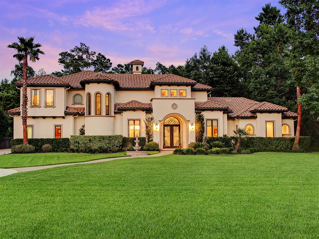 This magnificent custom home is nestled on a wooded 1.1-acre cul-de-sac lot in Benders Landing Estates. The gorgeous exterior features Cantera stone pillars and custom accents on all elevations. Beautiful, authentic Mediterranean clay tile roof signifies the quality of materials and attention to detail throughout the entire house.  The dramatic 24' ceiling in the formal living room and foyer provide a spectacular view through the double story windows into the lush backyard. Large glass windows and tons of natural light throughout. Vaulted, recessed ceilings in every room. Extensive custom tile work.  Solid wood doors.  Travertine tile and hardwood floors throughout (No carpet). Spacious, separate mother-in-law suite.  Forested backyard provides privacy and serenity.  25-yard lap pool with beautifully tiled spa.  Whole house water softener, tankless hot water heaters, water purifier, front and backyard mosquito system, 3 under-counter mini-fridges, and ice-maker, steam shower.