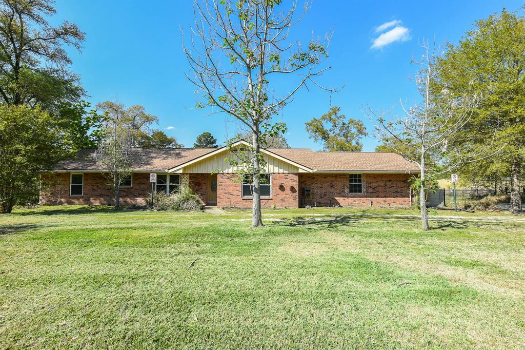 Great Location! 2 acres UNRESTRICED Commercial and/or Family used property.  The subdivision is just cross street from The Woodlands. It is 0.2 mile from the intersection of the Woodlands Pkwy and FM 2978 and just off FM 2978. Very  close to the Woodlands and all amenities! This is a must see for your business and/or family. This renovated home is all fenced with beautiful landscape. Commercial system expandable in front and backyard. The house has bedrooms, study, large family room and office/extra room.  Newer septic and patio cover, double pane windows, attic insulated R-45, tile laminate floors, granite counter tops, separated kitchen and family rooms.