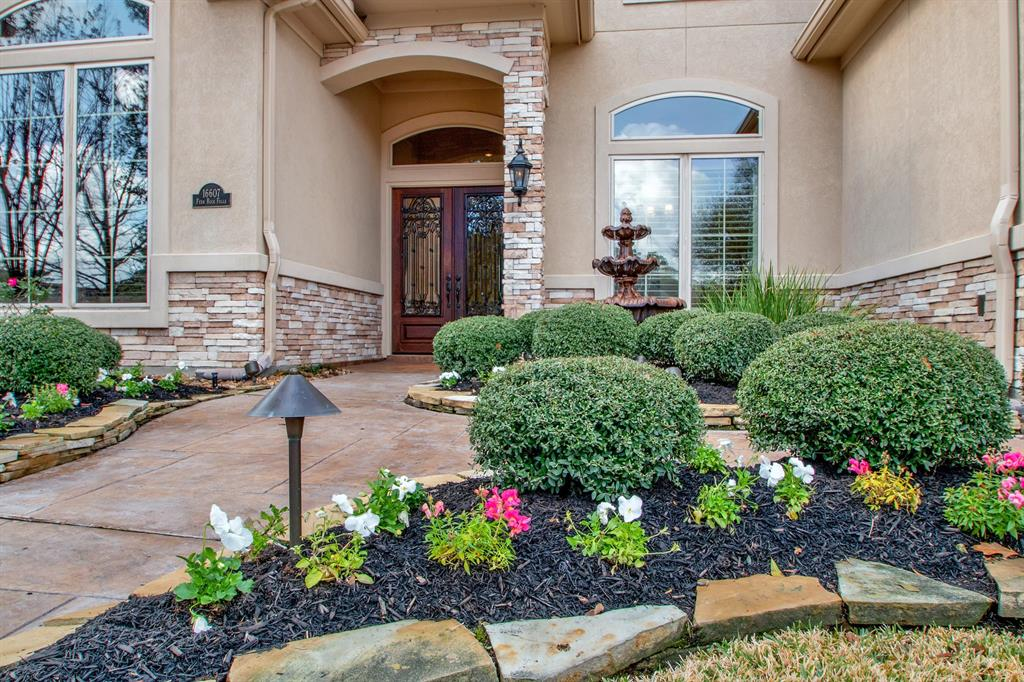 Enjoy this beautiful custom home in the gated community of Falls at Champion Forest.  Home sits on a quiet subdivision lot with a beautiful backyard retreat. The front door opens up to a well-designed floor plan for entertaining, from the front door to the back yard.  Large Master Bedroom leads out to back patio, and there is also a private guest suite in the back of the house with a full bath.  Over-sized kitchen with lots of cabinets and counter space, complete with double ovens.  Beautiful study with built-in shelves that look out into the professionally landscaped front yard. Upstairs, there are two bedrooms with Jack-n-Jill bathroom along with a game room.  Home boasts lots of storage with two walk-in attic spaces.  3-car garage with extra storage as well. The backyard retreat has a Gunite heated pool with spa, covered patio, and built-in grill, leaving nothing to desire.