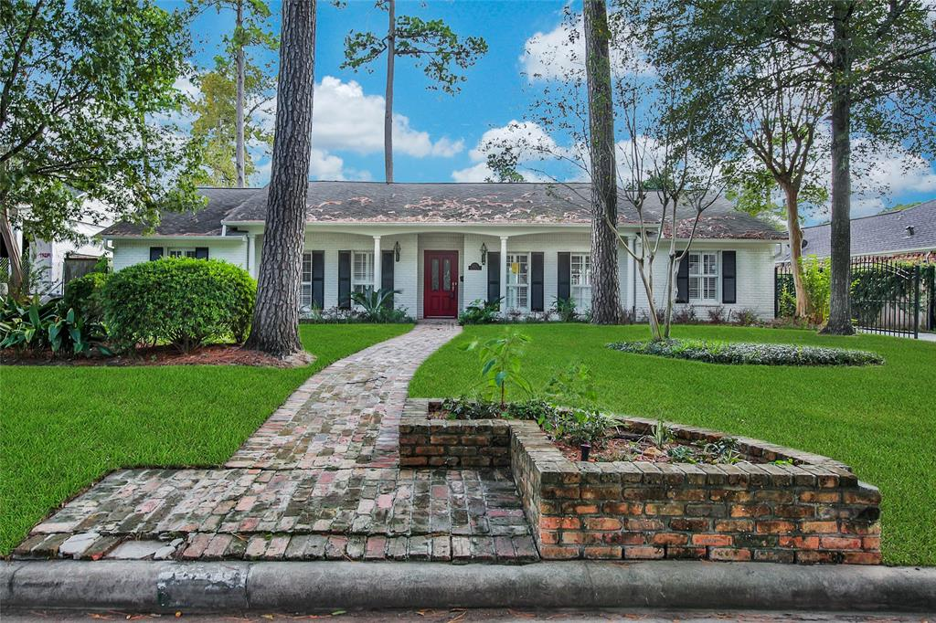 Beautifully renovated, colonial estate in the established Fonn Villas of Memorial zoned to exemplary Spring Branch ISD. As you walk the original brick path up the long front yard landscaped to perfection, you are welcomed by a beautiful red door accented by stately white brick elevation. Upon entering the home, gleaming hardwood floors dramatizes the seamless open floor plan & soaring ceilings. Well appointed Chef's kitchen w/connected workstation & walk-in pantry features beautiful granite counters on top soft-close cabinets. The east wing houses three spacious secondary bedrooms and massive Master Suite w/a true walk-in closet & extra storage throughout. The Master luxurious 5-piece retreat offers details on par with 5 star hotels. Nestled on immense lot with plenty of backyard space, you are within walking distance to grocery stores, dining, Memorial Green, Starbucks and minutes to Town & Country, Memorial City Mall, shopping & entertainment. Open houses every weekend. Welcome home!