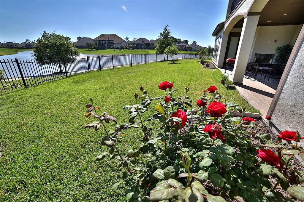 Gorgeous sought after LAKE FRONT home. Located in Katy's premier gated community Monterrey at Westlake! So many upgrades - a true luxury living!!! Grand entryway features with Wrought Iron Grilles double doors, beautiful tile floor thru out the living room and kitchen area, wood floor in formal dining and 1st floor bedrms. Two bedrooms downstairs including master bedroom. Second bedroom is perfect for in-laws or guest. Study room is perfect for someone work from home. Formal dining room is an entertainers dream! Gourmet kitchen features SS appliances, custom cabinets, walk in pantry, double islands and beautiful custom granite.  Master bedroom features hard wood floor, shutter blinds, tall windows perfect for lake view. Two large bedrooms, game room, media room and a balcony at 2nd floor. Overseeing the magnificent lake view from balcony, perfect for enjoying a relax moment after a long week. Zoned to award winning Katy independent school district. Walking distance to Tompkins HS.