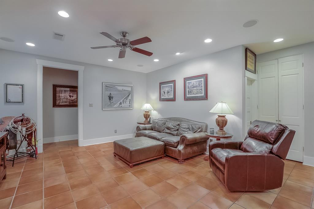 Large family room that opens to the kitchen is the perfect space for relaxing with the family or watching the big game.