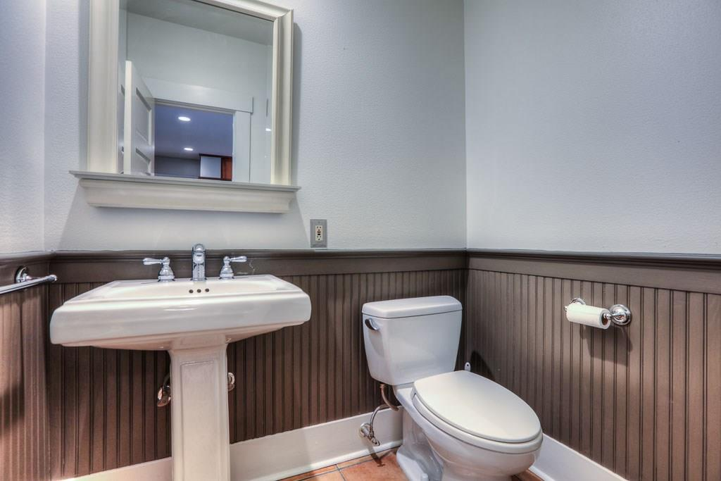 Half bath is located adjacent to the family room which is ideal for guests.