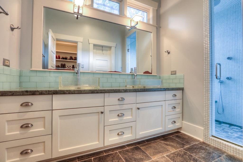 Updated master bath features dual vanities.