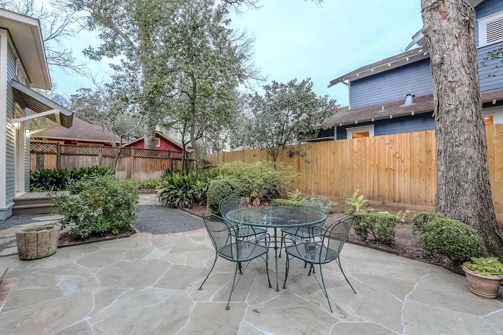 This over-sized lot features mature landscaping and two stone patios.