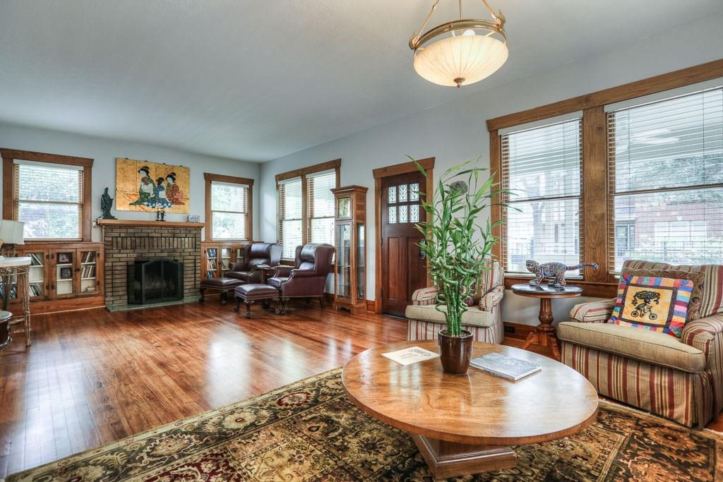 This large formal living room features refinished original hardwood floors, built-in bookcases and beautifully restored trim work.