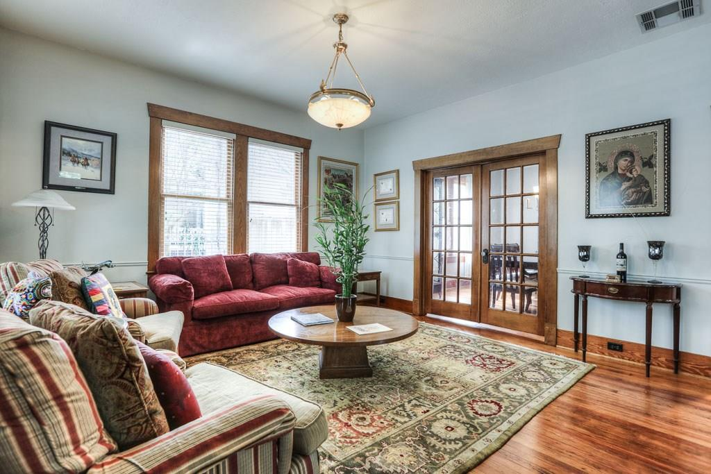 The French doors from the formal living room lead to the dining room.