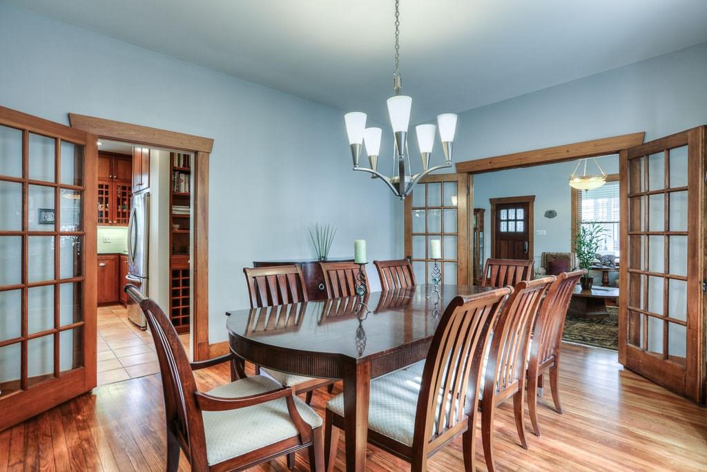 The large dining room easily accommodates this 8 person dining table.