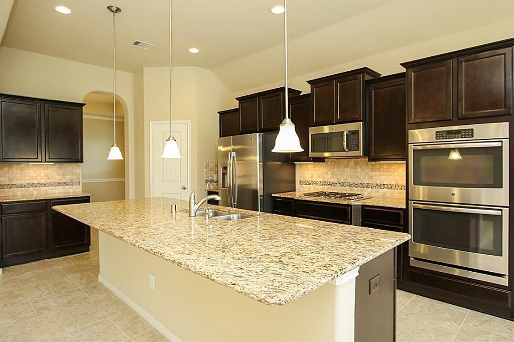 Awesome single story recent construction DR Horton home in Jacobs Reserve with 3 Bedrooms, 2.5 baths and a three car (tandem) garage. Great layout for the way people live today.  Kitchen with high end, stainless appliances, stone counters, and enormous island open to the family room which features a cast stone fireplace with gas logs.  There is a large dining room plus a separate breakfast area.  Study with french doors opening onto the rotunda with spot-lit art niches   Tile floors in all living areas.  Large master with tray ceiling and double doors to spacious spa bath with separate tub and glass shower.  Master closet the size of many bedrooms has room for everything.   There is a covered patio plumbed for an outdoor kitchen, water softener, Woodlands Schools in the Conroe School District. Refrigerator, washer, and dryer stay with the house. There is  splash pad at the end of the street and other neighborhood amenities include parks, lakes, and a swimming pool.