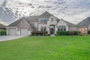 Custom brick and stone home in the gated neighborhood of Grand Harbor.