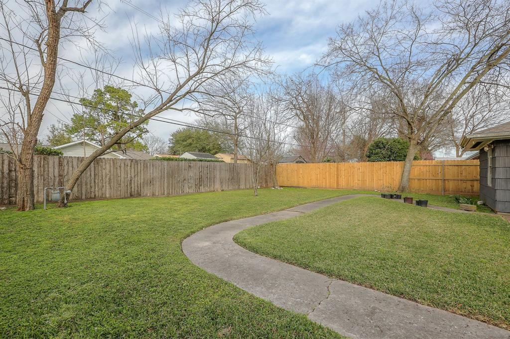 Very large, fully fenced backyard. So many possibilities and activities!