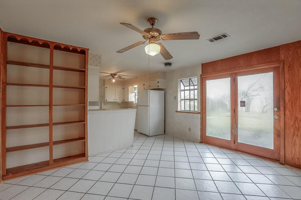Den is open to the Kitchen and backyard access. Very spacious!