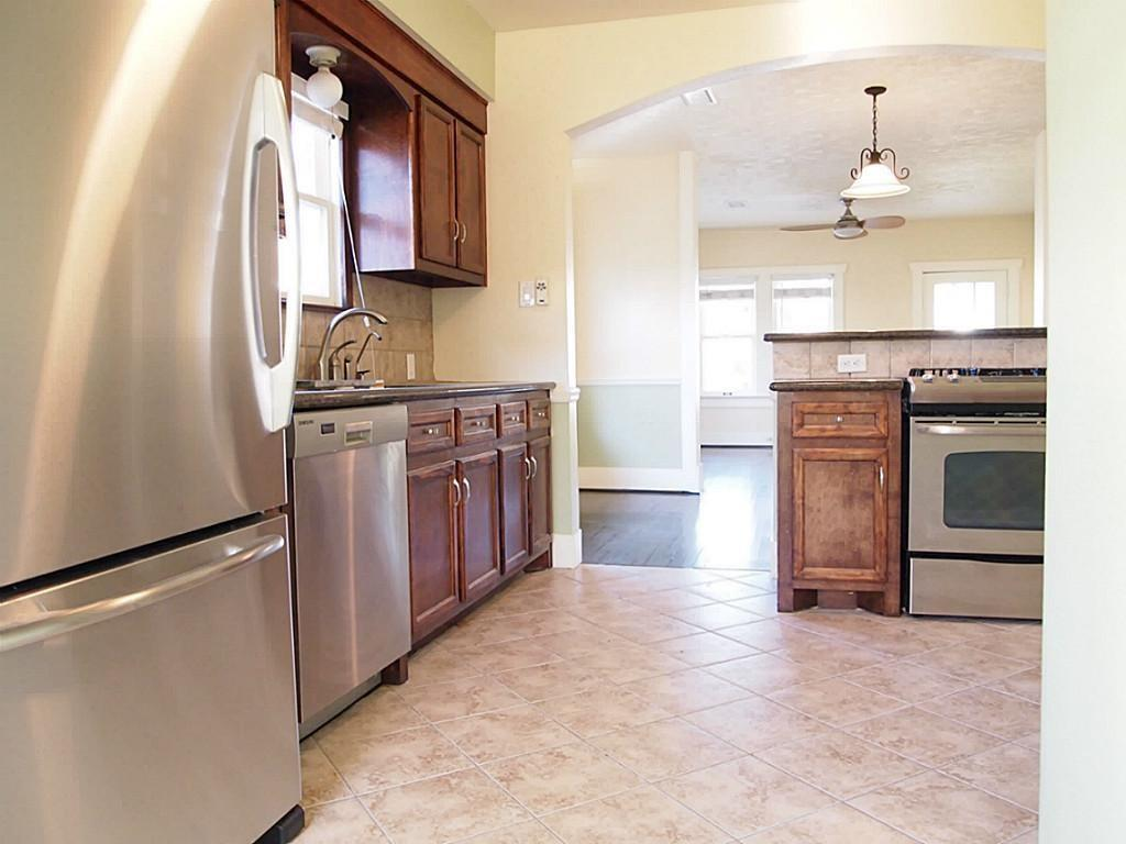 The updated kitchen features granite counter tops and stainless steel appliances.