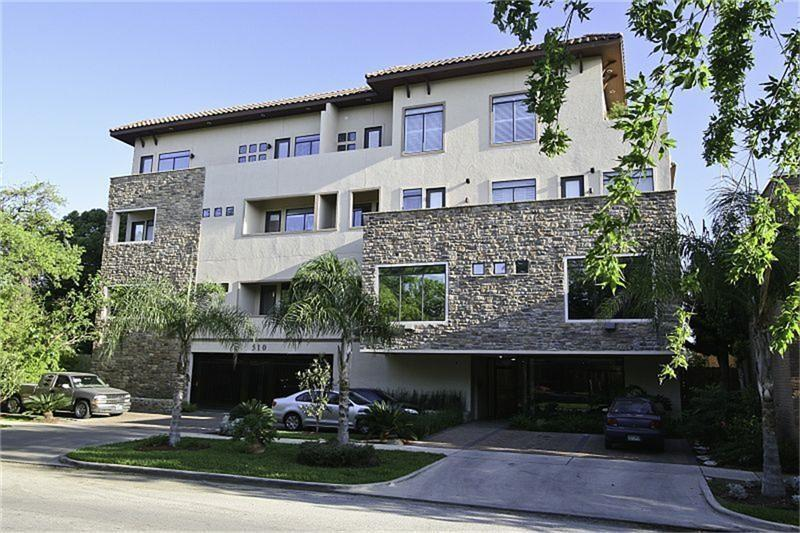 PERFECTLY LOCATED on the prettiest tree lined street in Montrose; own part of Houston history in this gorgeous 2/2 condo recreated from the old KLOL radio station building; open floorplan, wood floors, granite counters, SS appliances, natural gas cooking, and much more; both bedrooms are large and both have walk-in closets; no need to pay for gym membership with the fully furnished workout room on the first floor; restricted building entrance and assigned parking in a gated garage for security; DON'T MISS looking at the rooftop terrace that offers a stunning view of the downtown Houston skyline; walk to grocery, pharmacy, medical clinic, numerous restaurants/clubs, metro stop, Starbucks, and University of St. Thomas.  Only 25 units in this highly sought after building with some off street guest parking spots....YOU WILL LOVE LIVING HERE!!!