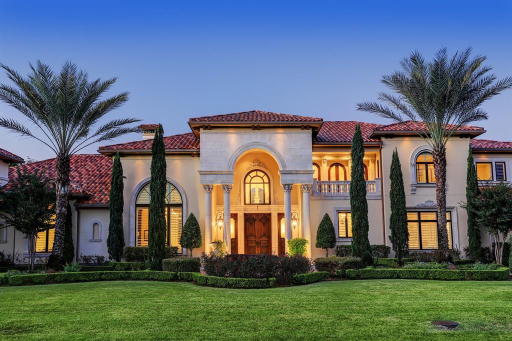 Extravagantly-styled Mediterranean estate in Memorial Villages. Grand entry with dramatic 20+ foot ceilings, vaulted archways and marble floors. Formal living spaces. Mahogany study. Chef's kitchen with two granite islands with breakfast bar and additional catering kitchen. Luxurious master suite with sitting area, spa-like bathroom with steam and rain shower, Whirlpool tub and separate water closets and dressing areas, and attached flex/massage room. Home theatre with tiered seating. Brick and plaster wine room with barrel vaulted ceiling. Walls of butted glass provide views of the resort style backyard, which offers a pool, hot tub, covered cabana with rain curtain, built in fire pit and outdoor kitchen.
